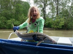 Grace with her first sturgeon of the season!